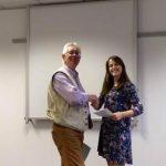 Jeff presents awards to Harriet